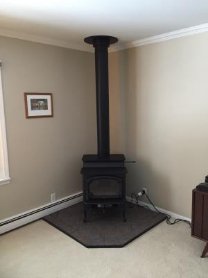 Lopi Endeavor Wood Stove On A 4Ft x 4Ft Tartara Corner Hearth Pad